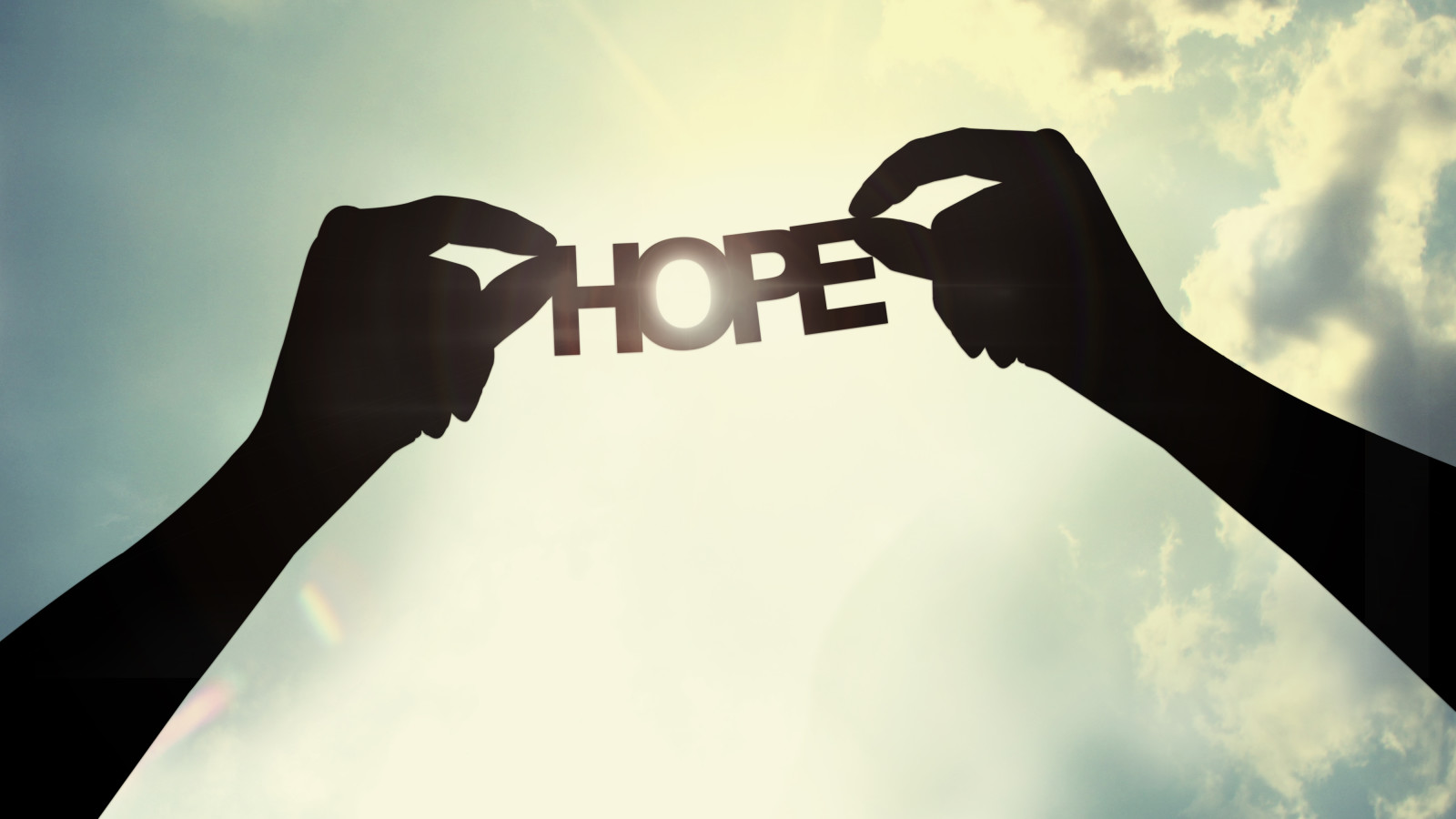 holding a paper cut of hope shutterstock_137307233